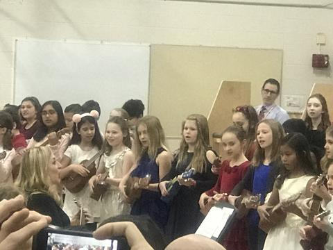 students playing ukelele