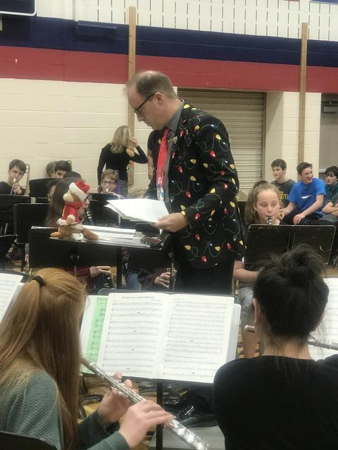 band conductor in christmas suit