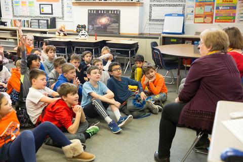 students listening to presenter