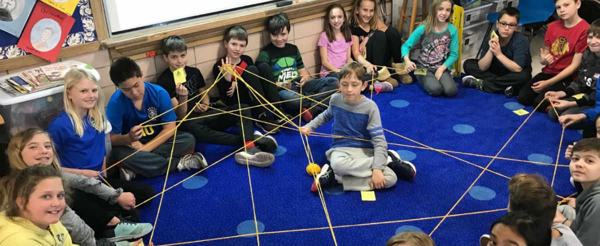 Students with man made spider web