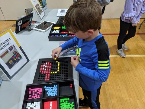 young student using cubes