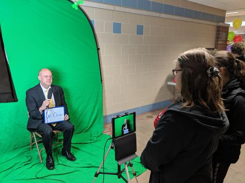 Dr. Olson in front of green screen