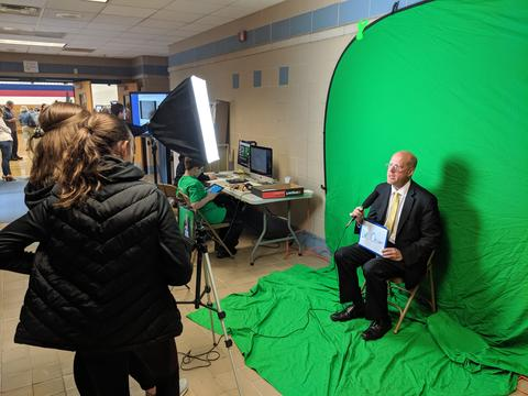 New Superintendent in front of green screen