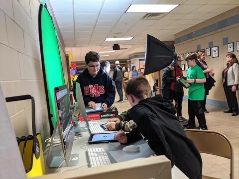 students working at green screen