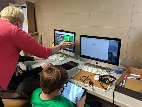 Instructional technology coach helping students