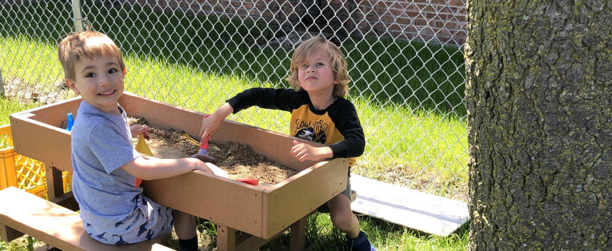 Students at sand table