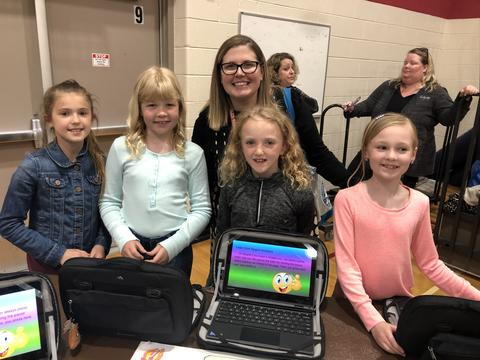 Students with teacher and chromebooks