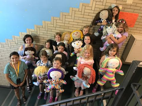 students with dolls
