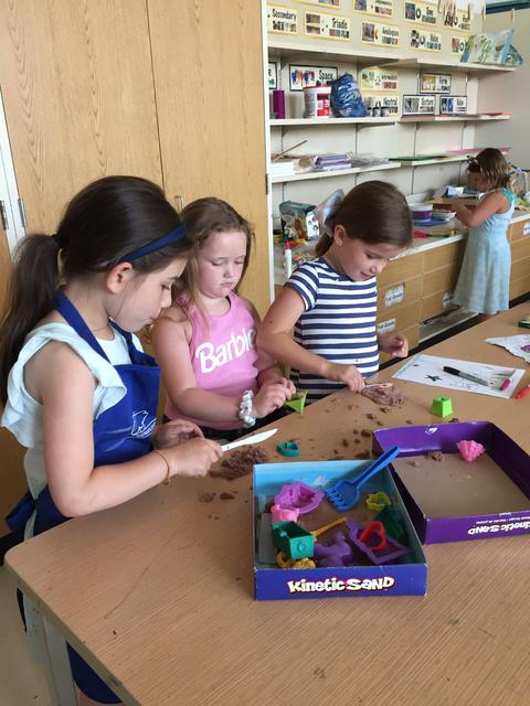 students building with clay