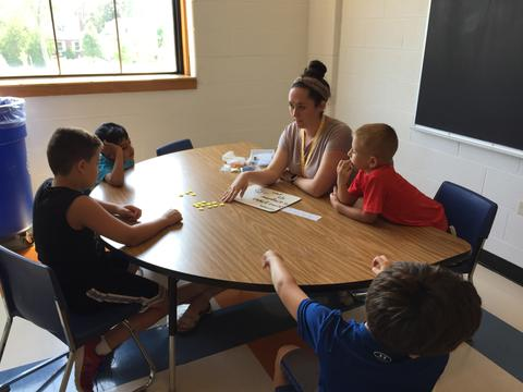 students working with teacher