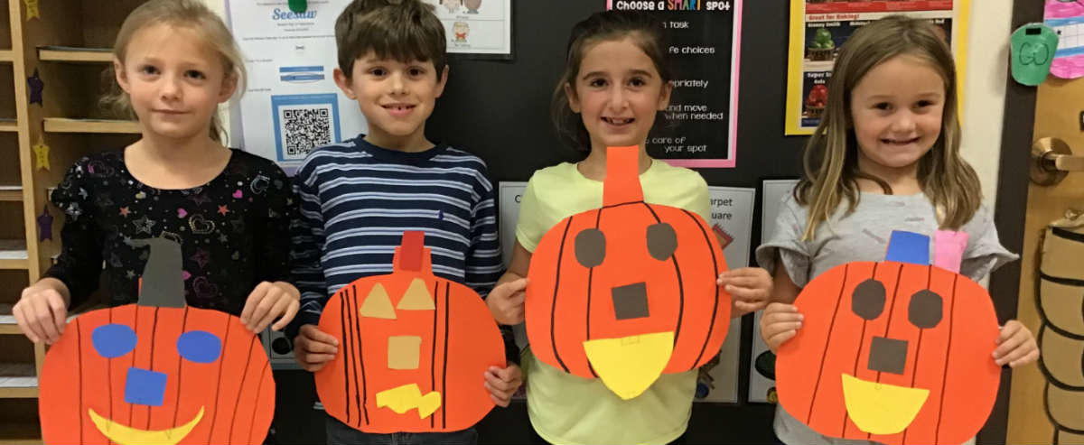 Students with pumpkins made