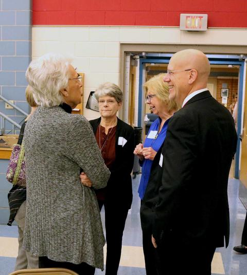 District 64 Superintendent Eric Olson chats with retired employees.