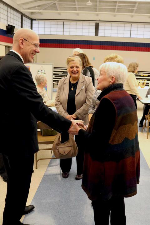 Dorothy Hendee, wife of former Superintendent the late Raymond Hendee, greets new Superintendent Eric Olson.