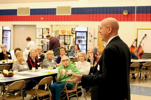 District 64 Superintendent Eric Olson speaks to retired employees