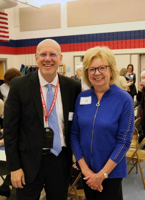 District 64 Superintendent Eric Olson poses with retired Superintendent Sally Pryor
