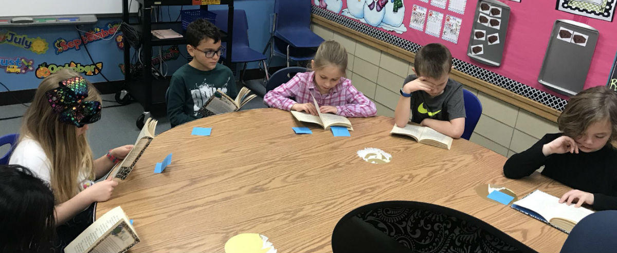 Students reading around table