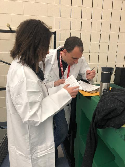 Principal and Assistant Principal judging mystery box