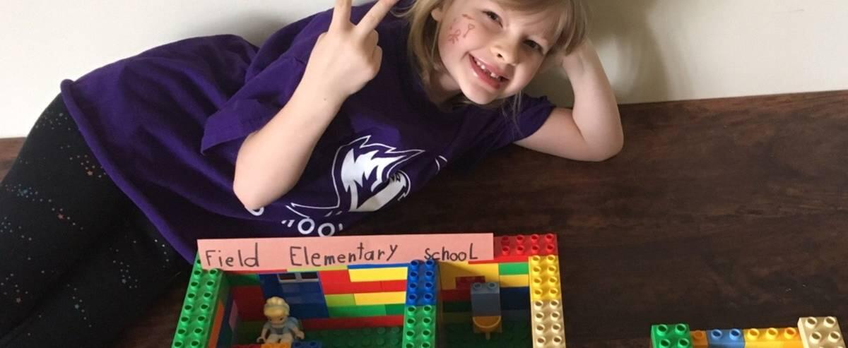 Field Student Building Legos of School At Home