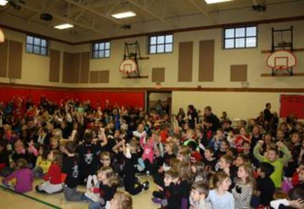 Exciting Day at Carpenter - Track-a-Thon Assembly and a Visit from Maine South Football Players