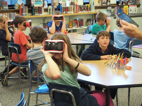 Many students using Google Virtual reality viewers