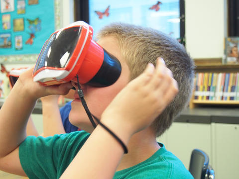 Student using plastic virtual reality veiwer