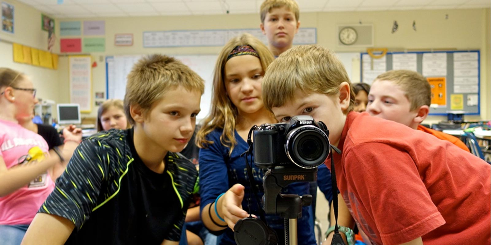Kids behind a camera lens