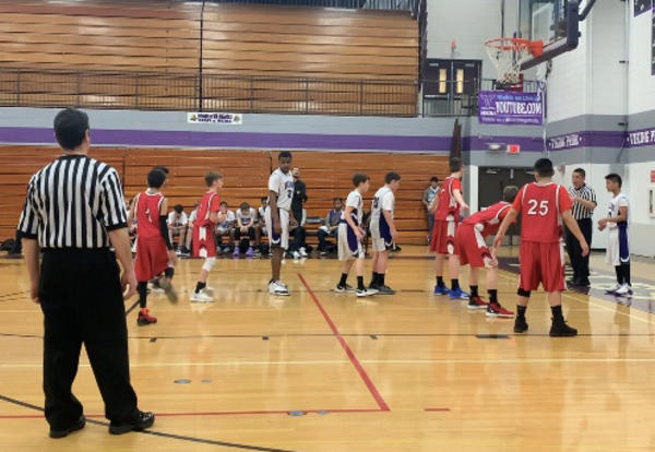 Seventh-grade boys take 'Little Nine' basketball title