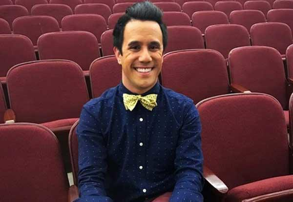 Graceland alum Tommy Ratkiewicz-Stierwalt in the theatre he teaches performing arts in