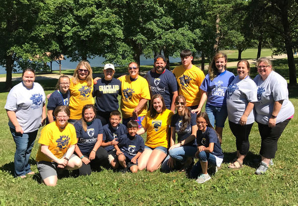 A group of Graceland alumni, staff, students and future students who volunteered at Camp MOJA