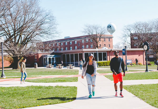 Female and male student walking the Lamoni campus between classes