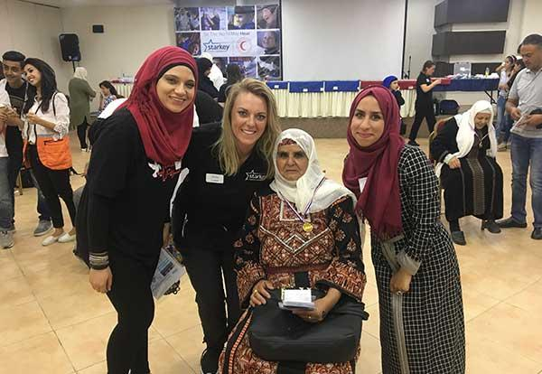 Graceland alum Elizabeth Sweet with recipients of Starkey Hearing Foundation services in Palestine