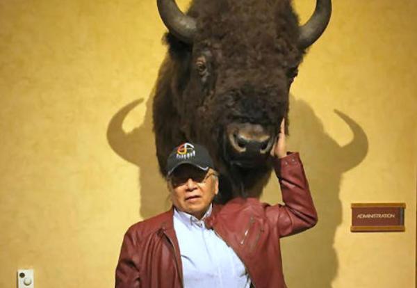 Ray Slick poses with a stuffed buffalo head.