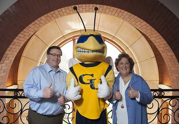 President Pat Draves and her husband, Jeff Draves with Sting, Graceland 's mascot