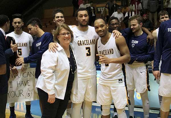 President Pat Draves with a couple of the national championship men's basketball players