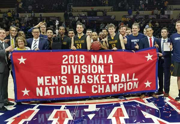 The Graceland men's basketball team following their winning game at the 2018 NAIA Division I Men's Basketball National Championship.