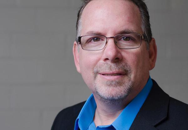 Professor of Education Dennis McElroy