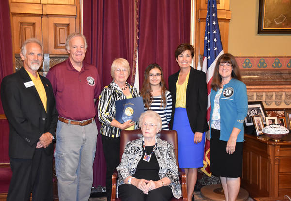 Shirley Kessel and group at Iowa State Capitol receiving award with Gov. Kim Reynolds