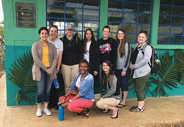Group of nursing students in front of newly built school in Guatemala