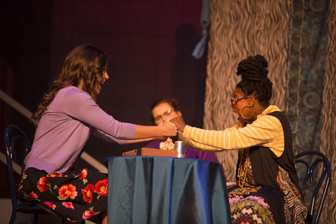 Haley Johnson and two female actors perform together on-stage.