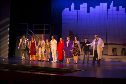 Full cast on stage for bows