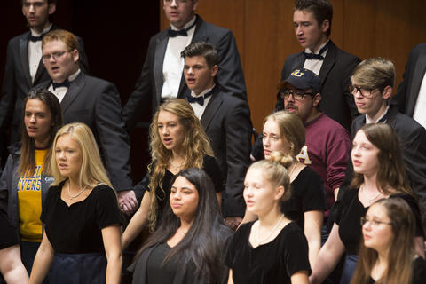 Two Alumnist singing with the Concert Choir