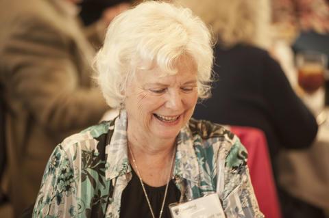 Smiling Female Alumnist