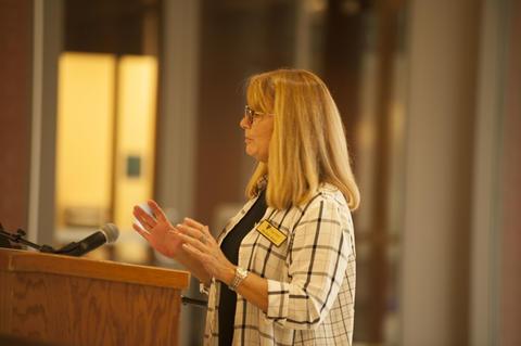 Female Alumnist talking to crowd