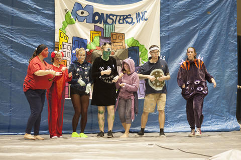 characters from monsters inc. on stage