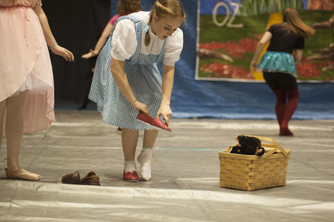 Dorothy putting on her red slippers