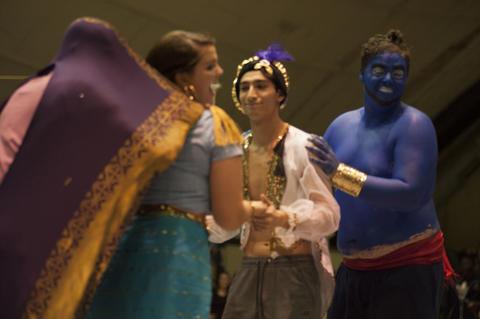Aladdin, Genie, Jasmine and Carpet dancing on stage