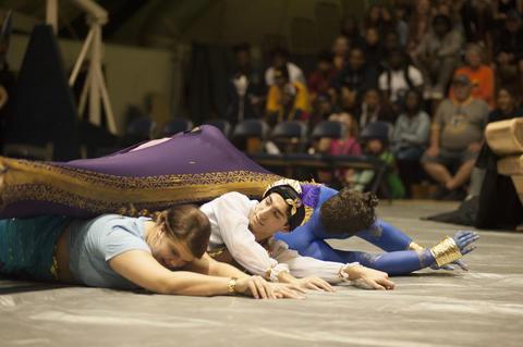 Aladdin, Genie, Jasmine, and Carpet on stage