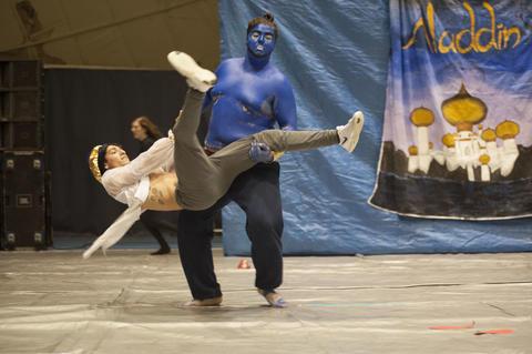 Aladdin and Genie on stage