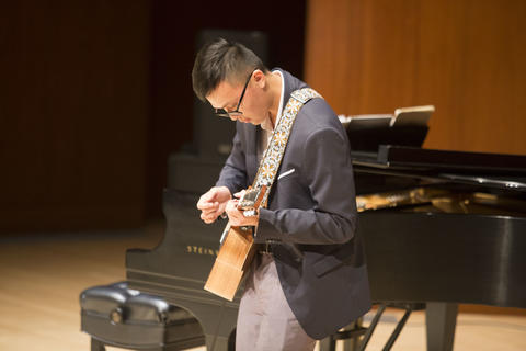 Current student playing guitar