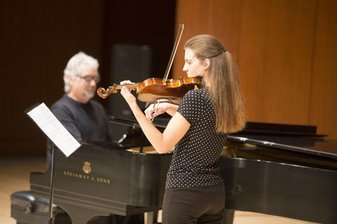 Jack and current student playing piano and violin